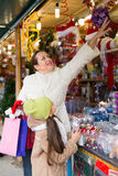 Girl with mom buying decorations Royalty Free Stock Images