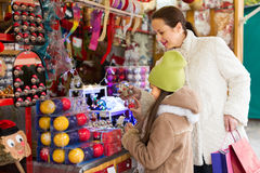 Girl with mom buying decorations Royalty Free Stock Photos