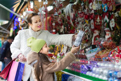 Girl with mom buying decorations Royalty Free Stock Photography