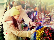 Girl with mom buying decorations Stock Photo