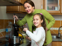 Girl and mom with casserole Stock Photos