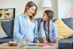 Girl with Mom Drawing royalty free stock photography