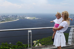 Girl and mom at a high viewing platform Stock Photos