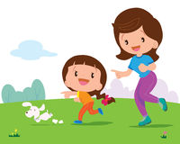 Girl and mom Jogging. Mother and daughter jogging with cute dog in the park Royalty Free Stock Photography