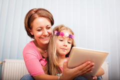 Girl and mom with notepad Royalty Free Stock Photos