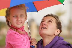 Girl and mom  umbrella of color Royalty Free Stock Photography