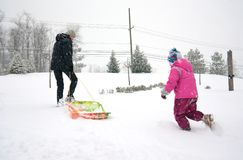 Girl with Mom and winter fun Royalty Free Stock Photos