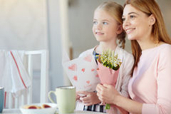 Girl with mom. Young women with wildflowers and her daughter with greeting-card Stock Photos