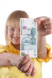 The girl and the monetary denomination Royalty Free Stock Images