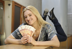 Girl with money. Beautiful girl posing with money Royalty Free Stock Image