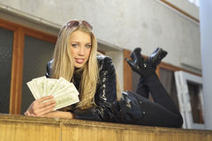 Girl with money. Beautiful girl posing with money Stock Image
