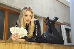 Girl with money Stock Image