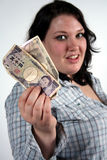 Girl with money. A Girl with Japanese money royalty free stock photos