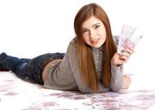 Girl with money Stock Photos