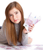 Girl with money Royalty Free Stock Images