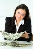 Girl and money Stock Photos