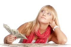 Girl and money Stock Images