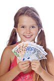 Girl with money Stock Images