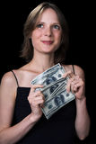 The girl and money Royalty Free Stock Photography