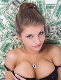 The girl and money Stock Photo