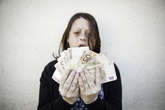 Girl with money bills Stock Photography