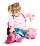 Girl with money box. Adorable girl putting its savings in your money box. Over a white background royalty free stock images