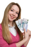 Girl with money and credit card on hands. Young smiling girl with money and credit card on hands. Isolation on the white Royalty Free Stock Photo