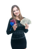 Girl with money and giftbox in her hands. Portrait of girl with money and giftbox in her hands isolated on white Royalty Free Stock Images