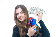 Girl with money and giftbox in her hands. Portrait of girl with money and giftbox in her hands isolated on white Royalty Free Stock Photo