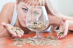 Girl money and a glass Royalty Free Stock Images