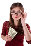 Girl with money in glasses Stock Image