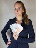 Girl with money in hand.  Royalty Free Stock Images