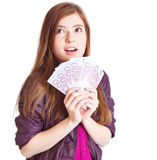 Girl with money in hands. Isolated on white background Royalty Free Stock Photo
