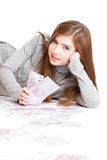 Girl with money in hands. Isolated on white background Royalty Free Stock Photos