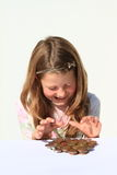 Girl with money. Girl - kid with money - savings of czech crowns - small change Stock Photo