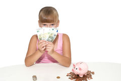 Girl with money and piggy bank isolated Stock Images