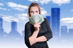 Girl and money. Smile and money in the hands of a young woman royalty free stock photo