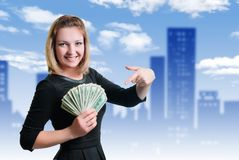 Girl and money. Smile and money in the hands of a young woman stock image