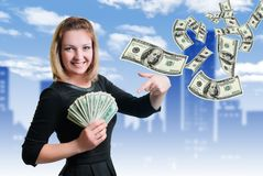 Girl and money. Smile and money in the hands of a young woman stock photography