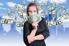 Girl and money. Smile and money in the hands of a young woman stock images