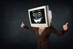 Girl with a monitor head and a cheerful cartoon face Stock Images