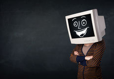 Girl with a monitor head and a cheerful cartoon face Stock Photos