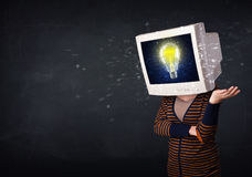 Girl with a monitor head, idea light bulb on the display s Royalty Free Stock Photos