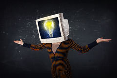 Girl with a monitor head, idea light bulb on the display s Stock Images