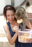 Girl with monkey Royalty Free Stock Photography
