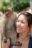 Girl with monkey. Girls with monkey, animal is not shy and sits on the shoulder Stock Image