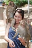 Girl with monkey Stock Photos
