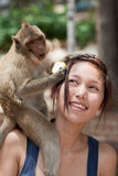 Girl with monkey Royalty Free Stock Image