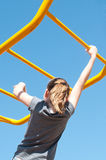 Girl on monkey bars Stock Photo