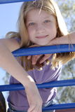Girl on monkey bars Stock Photography